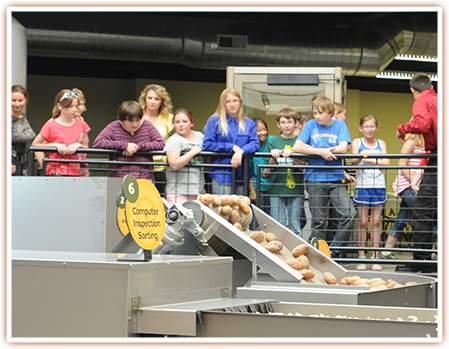 Students observing how potatoes are turned into french fries.
