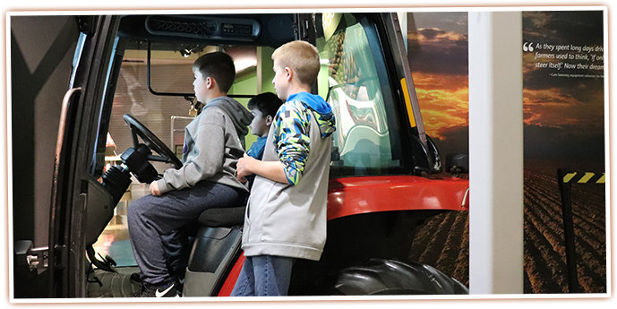 Visitors try their hand at driving a tractor at this interactive exhibit at the SAGE Center